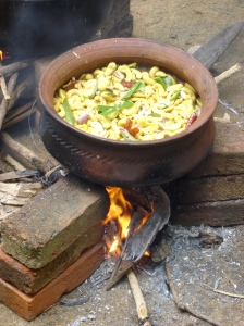 cashew curry cooking in a clay pot