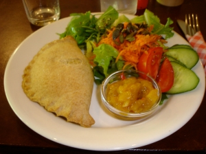 vegetarian empanada with chutney and a salad