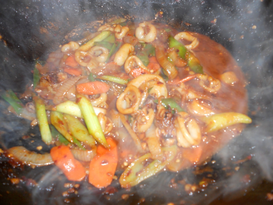 spicy stir-fry squid: steaming hot in the wok