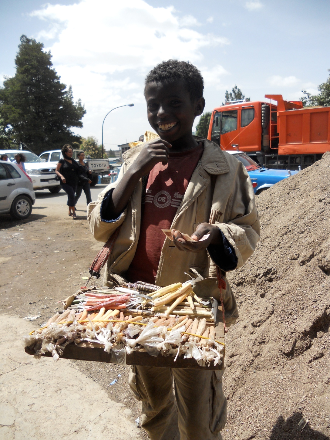 A young Ethiopian toothbrush salesman who bears an uncanny resemblance to 'Little Ze,' a character in the film City of God