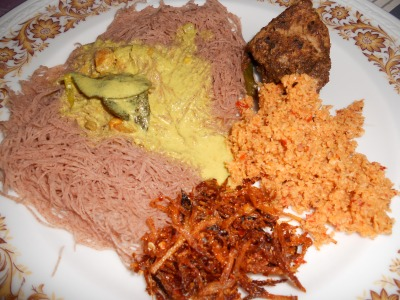string hoppers with fish ambul thiyal, kiri hodhi, pol sambol, and onion sambol