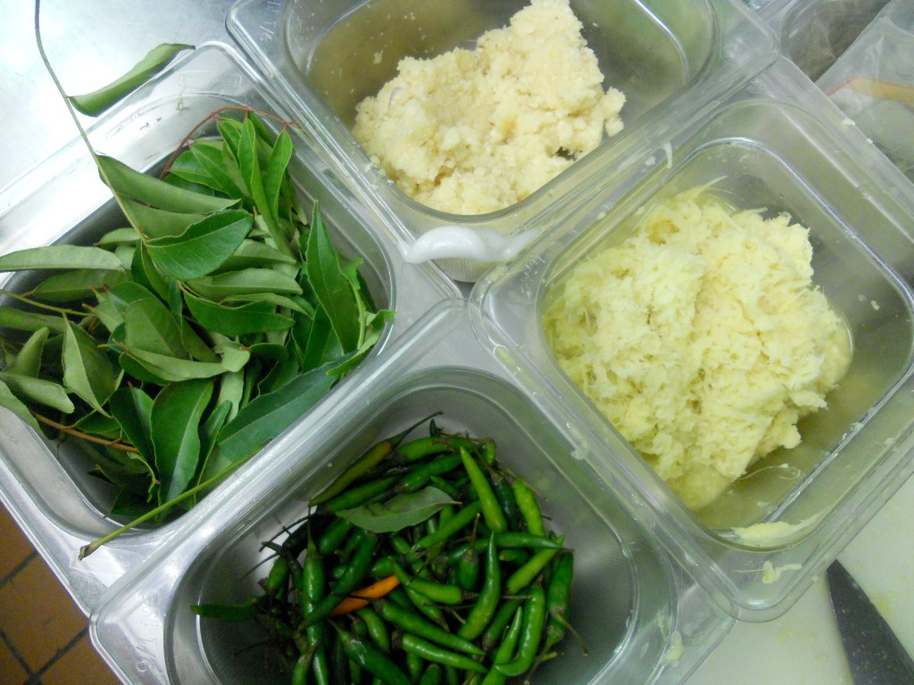 Sri Lankan mis en place -- green chilies, garlic, ginger & curry leaves