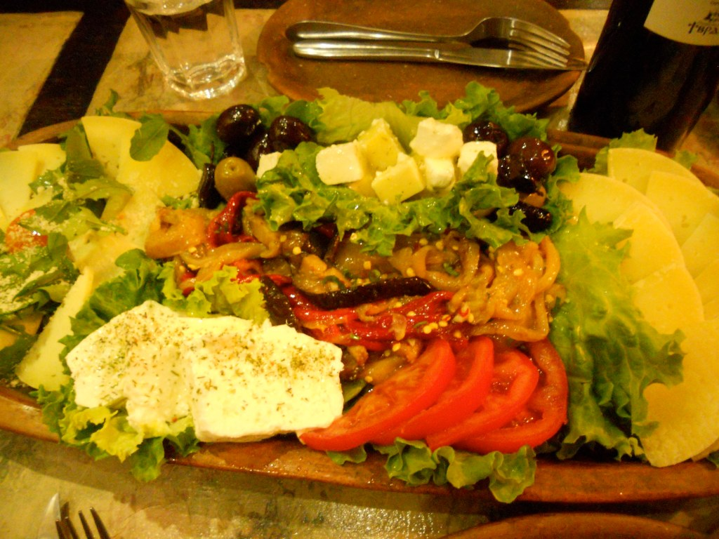 an assortment of cheese and roasted vegetables