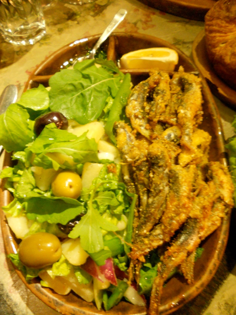 fried sardines with a salad